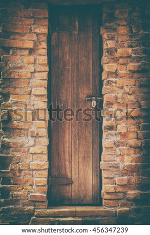 Old wood door and red brick wall on vintage style pictures