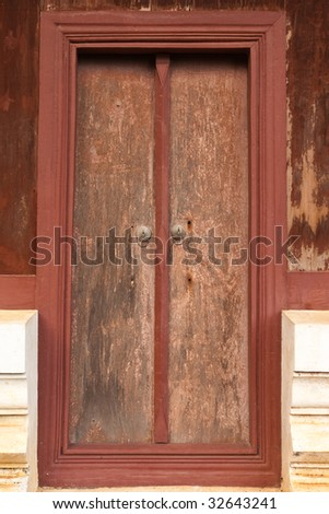 Old wood door of Buddhist church in Thailand