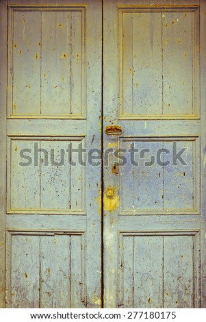 Old wood door painted with blue color - stock photo