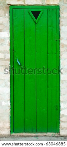 Old wood door painted with green color - stock photo