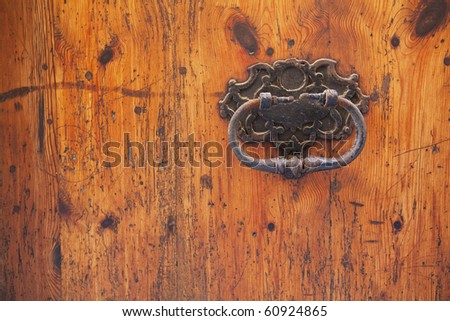 old wood door with rusty handle - stock photo