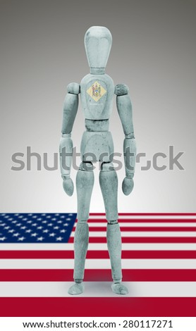 Old wood figure mannequin with US state flag bodypaint - Delaware - stock photo
