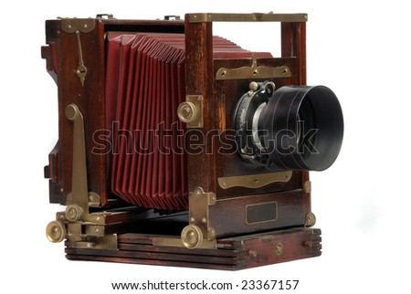 old wood frame photo camera with lens - stock photo