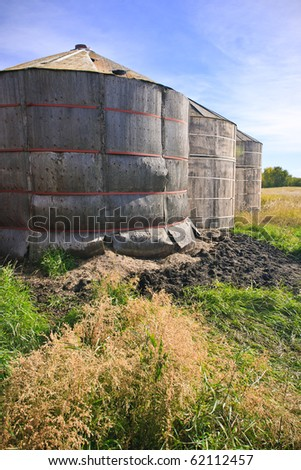 Old wood grain storage bins on the prairies - stock photo