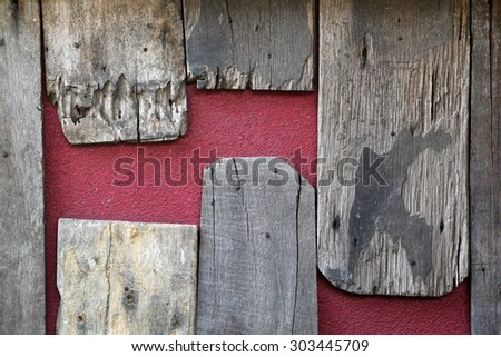 Old wood on red wall - background texture.