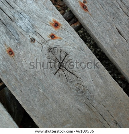 Old wood piece with wood eye - stock photo