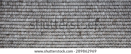 old wood shingle roof with rough surface, background - stock photo