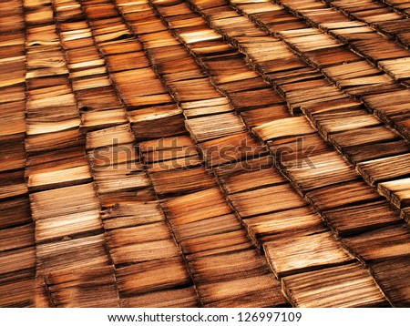 Old wood shingle roof with texture and brown color - stock photo