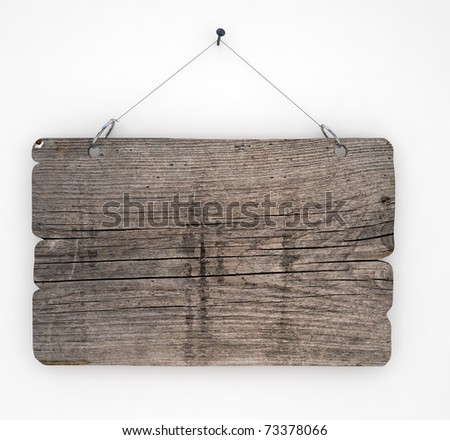 Old wood sign hanging on white wall - stock photo