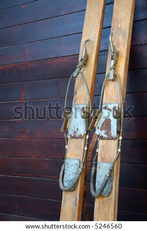 Old wood skis in the wood cabin - stock photo