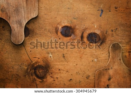 Old wood table with wooden boards makes a frame for text in rustic vintage style. Top view. Retro concept background. - stock photo