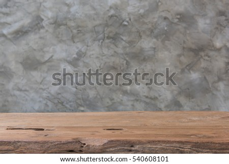 Old wood teak table interior with vintage loft cement background