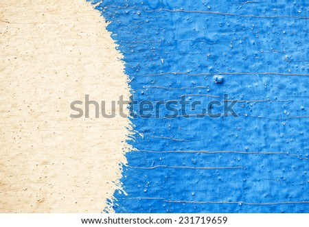 Old wood texture with cracked yellow and blue paint - stock photo