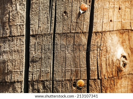 Old wood timber with hobnails - stock photo
