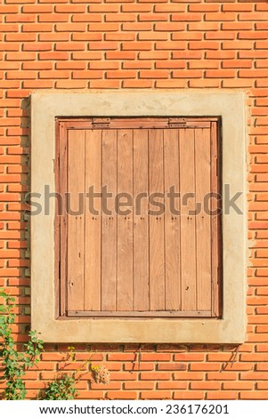 Old wood window and brick wall background - stock photo