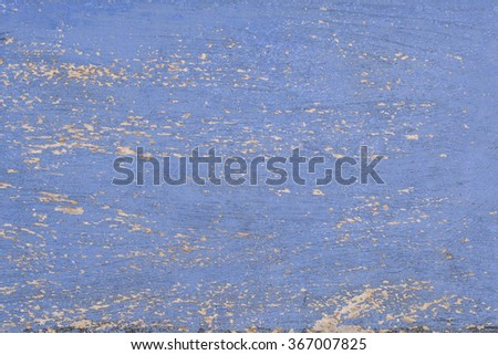 Old wood with fading cracked paint - stock photo
