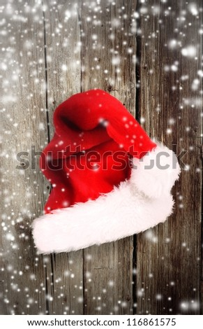 Old wood with santa cap - stock photo