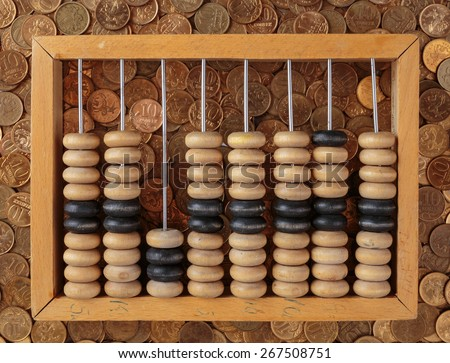 old wooden abacus on coins background - stock photo