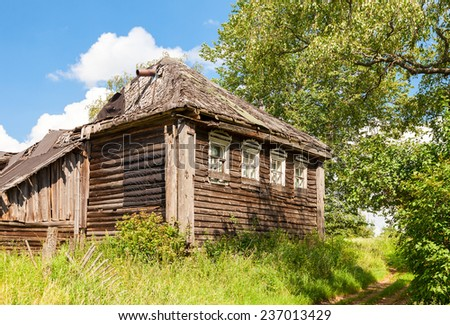 Old wooden abandoned house in russian village. Novgorod region, Russia - stock photo