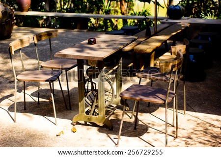 old wooden and steel chairs at the restaurant  in thailand - stock photo