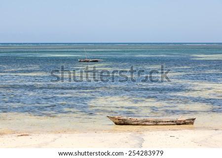 Old wooden arabian dhow - fishing boats -  in de ocean. Kenya, Africa  - stock photo