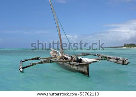 Old wooden arabian dhow in de Indian Ocean near Zanzibar. - stock photo