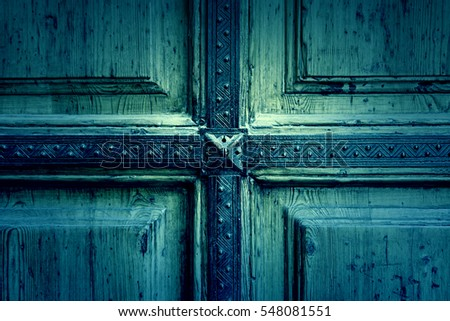 Old wooden background, detail of an old abandoned wooden door texture