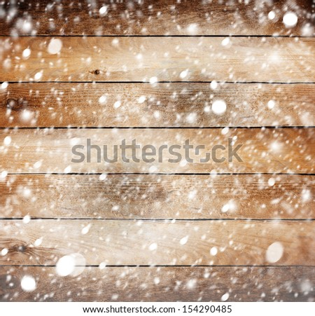 Old wooden background with snow for design - stock photo