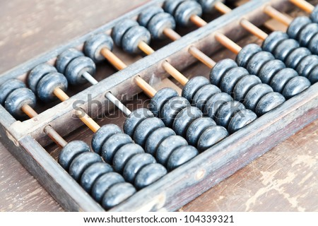 old wooden ball of abacus - stock photo