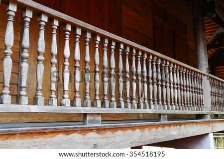 old wooden bannister of the balcony terrace