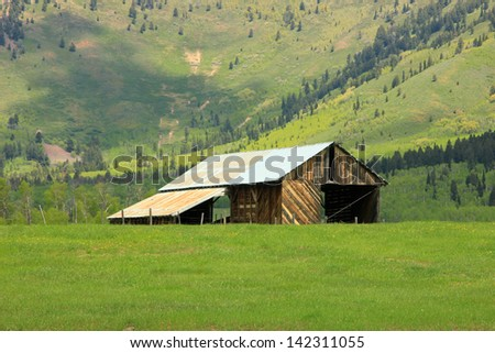 Old wooden barn in rural Wyoming, USA. - stock photo