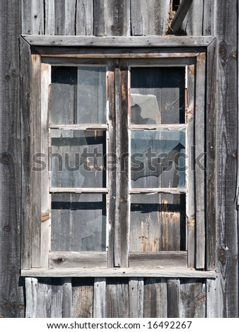 old wooden barn window with glasses cracked - stock photo