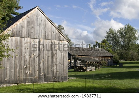 Old wooden barns in bright landscape
