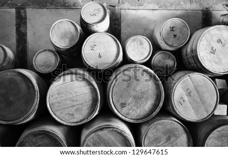 Old Wooden Barrels pilled up in a stack - stock photo