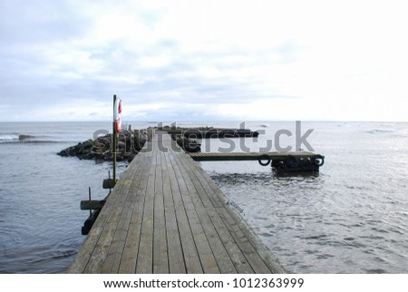 Old wooden bath pier by the coast of the swedish island Oland in the Baltic Sea