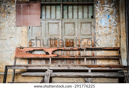 Old wooden bench against grungy background. Trang province, Thailand. - stock photo