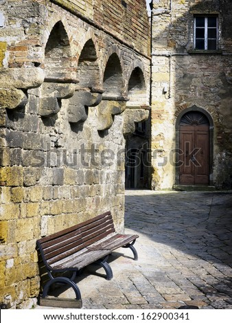 old wooden bench at siena - italy - stock photo