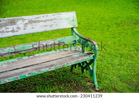 Old wooden bench in park. - stock photo