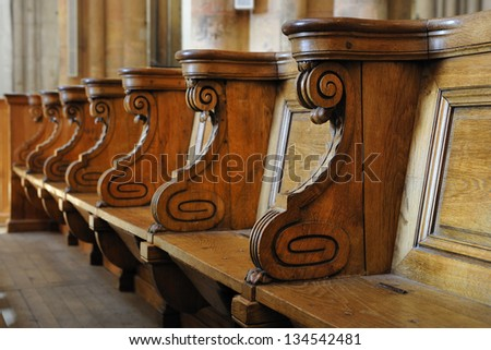 old wooden benches in the cathedral of Lyon - stock photo