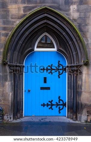 Old wooden blue castle door in Scotland - stock photo