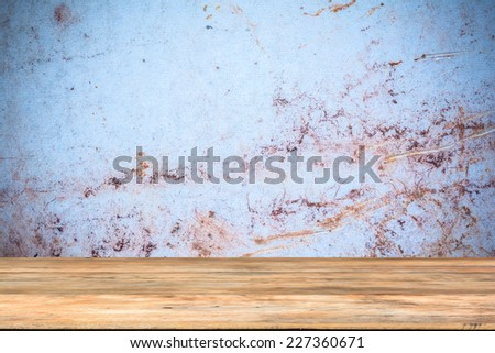 Old wooden board in front of old tile background - stock photo