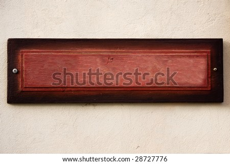 Old wooden board on a wall used to advertisement - stock photo