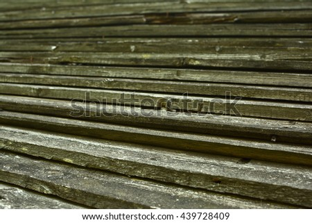 Old wooden board. Wooden wall with a shabby old paint. Fence. Wood texture. Cross section of the tree. - stock photo