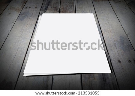 Old wooden boards and blank paper with space for text and copy - stock photo