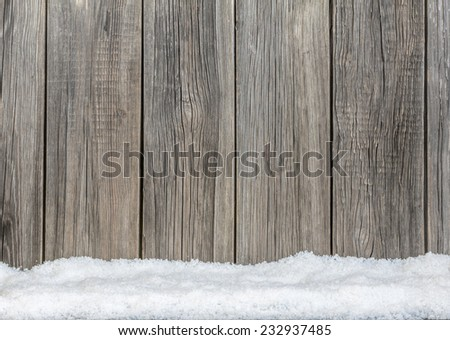 Old wooden  boards and white snow background - stock photo
