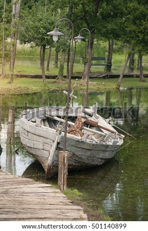Old wooden boat in shallow waters