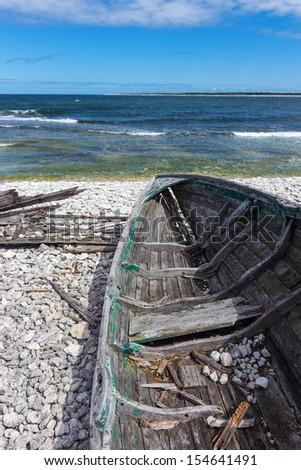 Old wooden boat on the seashore. Baltic sea, Fårö island, Sweden. - stock photo