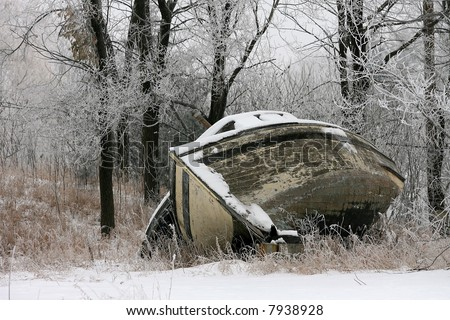 Old Wooden Boat with Frost-covered trees