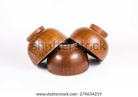 Old wooden bowl isolated on white background