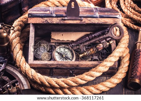 Old wooden box and retro nautical instruments.Toned - stock photo